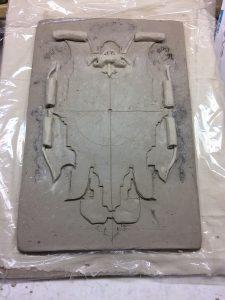 Orologio in creta e marmorino fase creta